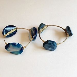 Two blue stone/gold wire wrapped bangle bracelets